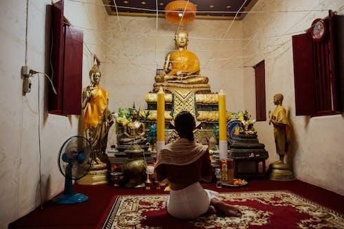 Gold Buddha Statue on Red Carpet