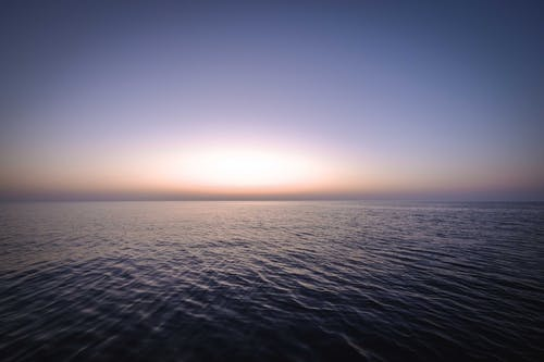 Peaceful scenery of sunset sky over rippling ocean
