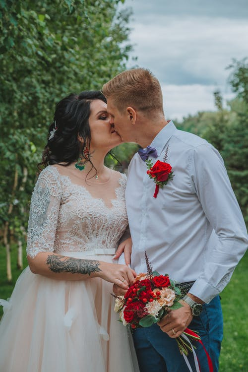 Loving newlyweds kissing  in nature