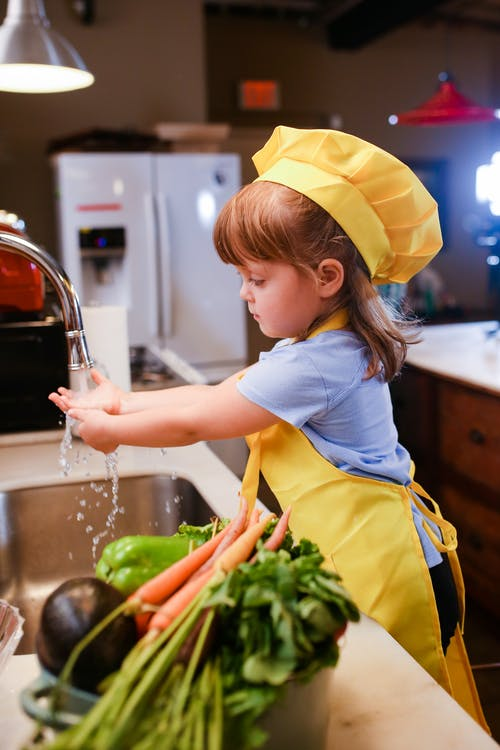 Girl in White T-shirt and Yellow Skirt in Kitchen
