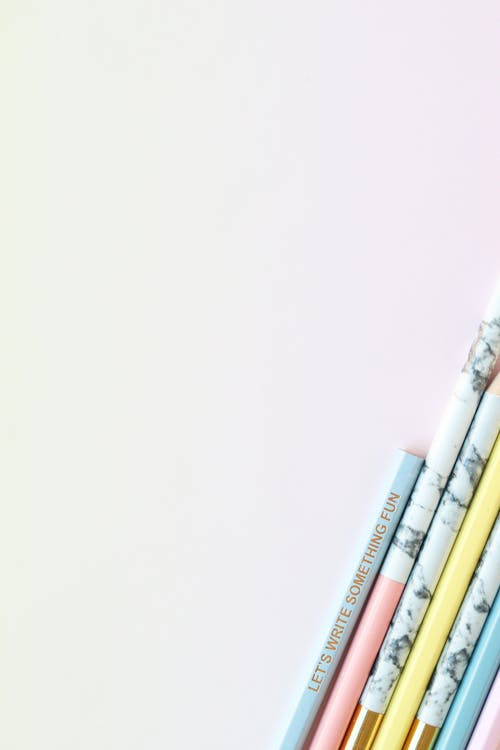 Set of pencils with inscription on light background