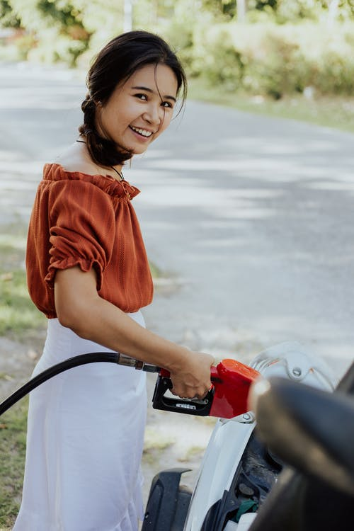 Girl in Red Dress Riding on Red Motorcycle