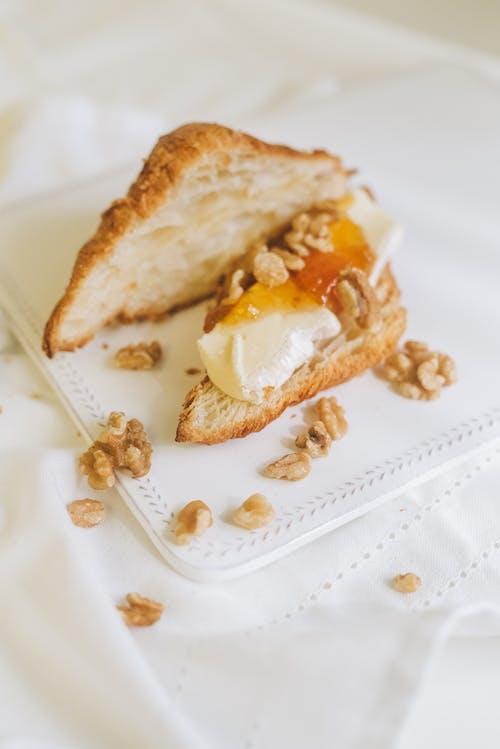 Bread With White Cream on White Ceramic Plate