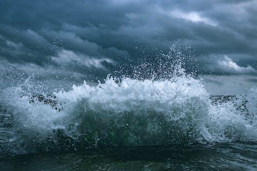 Ocean Waves Under Cloudy Sky