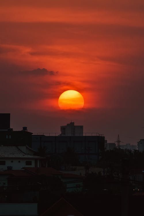 City building against orange sunset sky