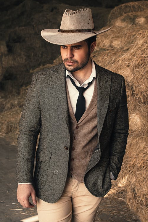 Man in Gray Suit With Brown Cowboy Hat