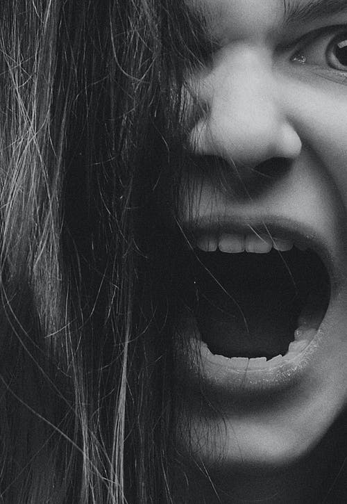 Grayscale Photo of An Angry Woman