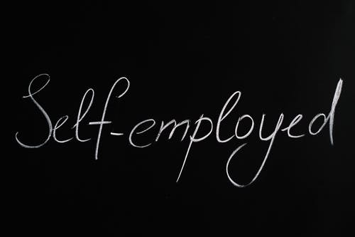 Self-Employed Lettering Text on Black Background