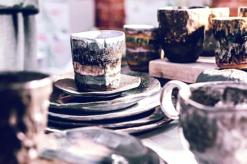 White and Blue Ceramic Mug on Black Round Plate