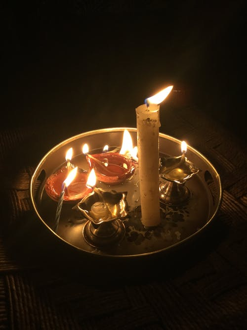 Lighted Candles on Round Golden Plate