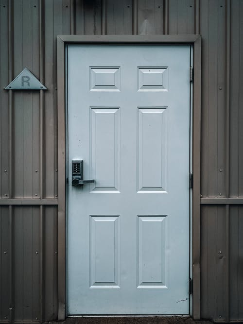 White door with modern lock