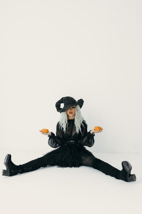 Woman Holding Pumpkins While Sitting On The Floor