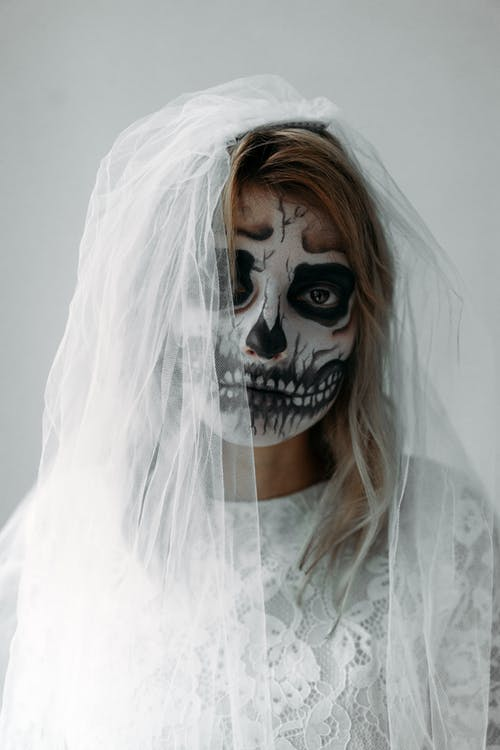 Portrait Of A Woman With A Scary Face Paint