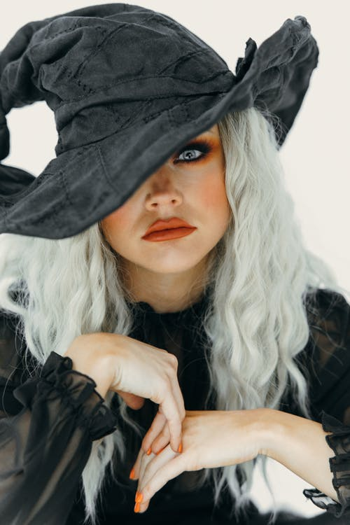 Portrait Of A Beautiful Woman in A Witch Costume