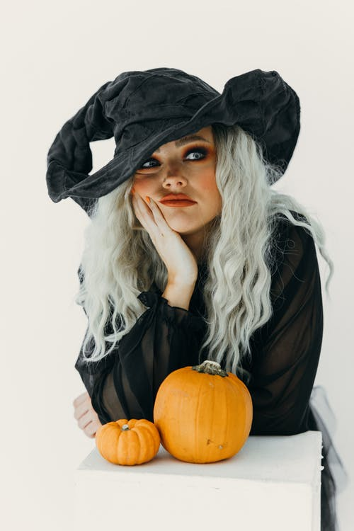 Woman in Witch Costume Feeling Bored