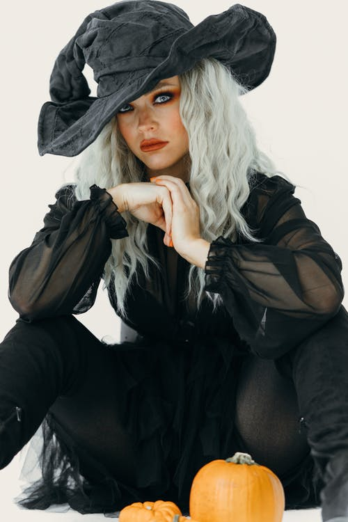 A Beautiful Woman Wearing A Witch Costume