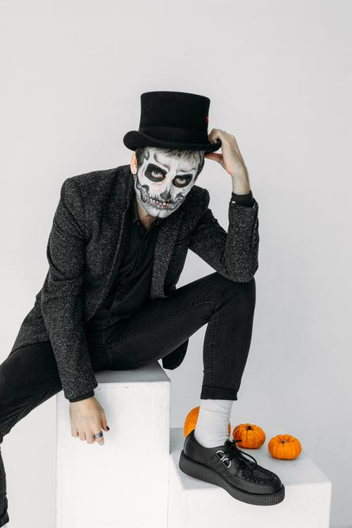 Man in Black Suit Jacket and Black Pants With Scary Face Paint