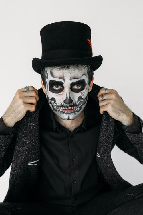 Man With Black and White Skull Face Paint