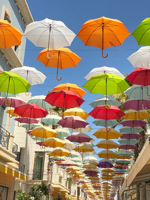 Colorful Umbrellas Over the Street