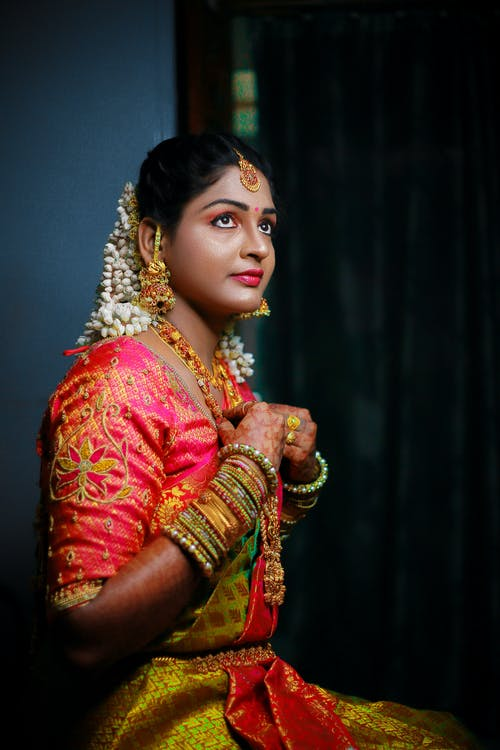 Woman Wearing Traditional Dress and Accessories