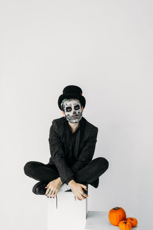 Man in Black Suit With Skull Face Paint