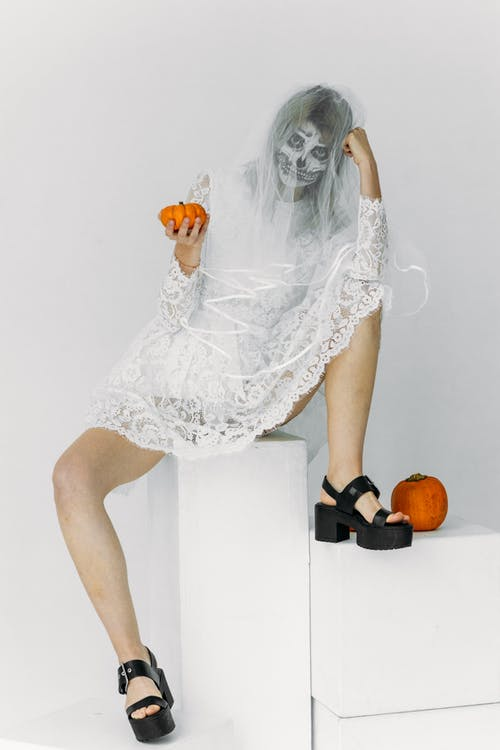 Woman in White Lace Dress With Face Paint