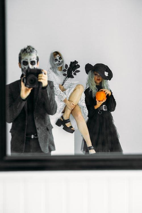 Three People Wearing Halloween Costumes
