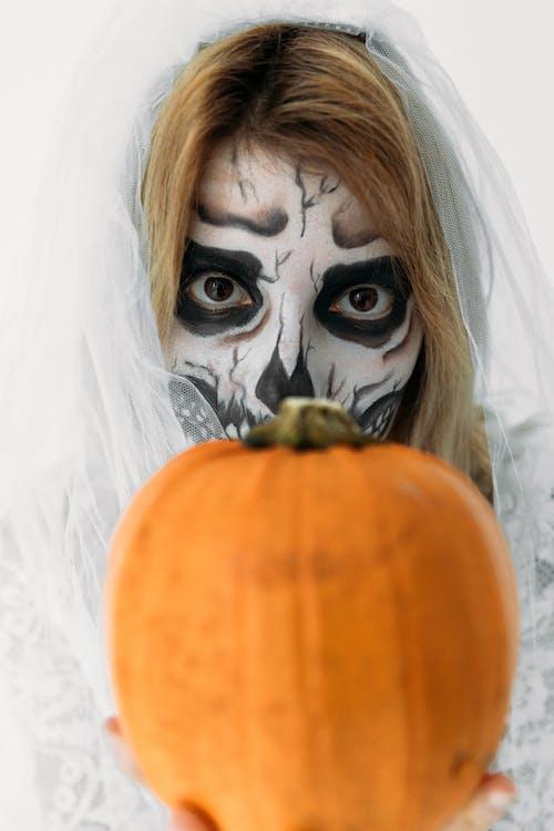 Woman With Orange Pumpkin