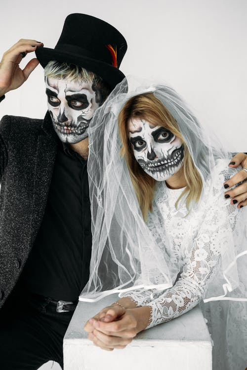 Man And Woman Wearing Skull Face Paint