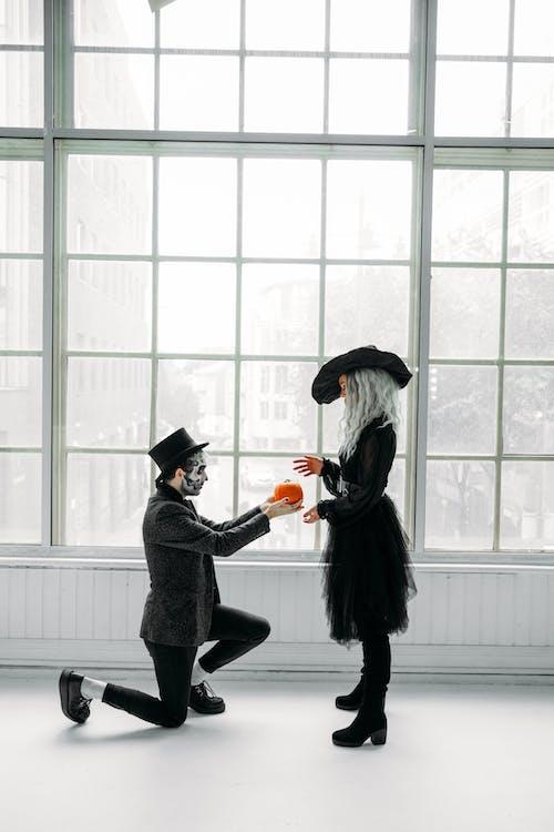 Man Giving A Pumpkin To A Woman