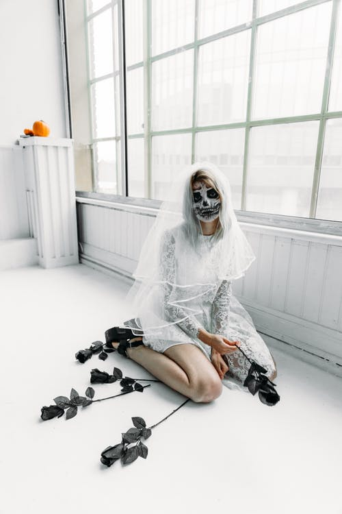 Woman in White Lace Dress Shirt Sitting on The Floor