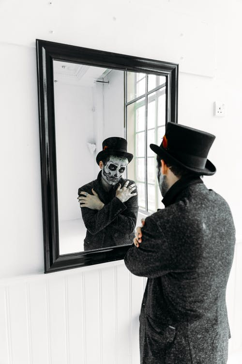 Man Standing In Front Of A Mirror