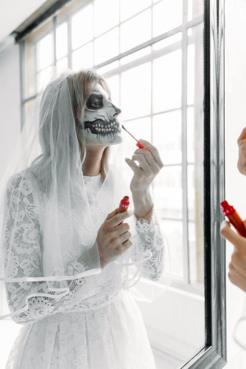 Woman in White Lace Long Sleeve Shirt With A Scary Face