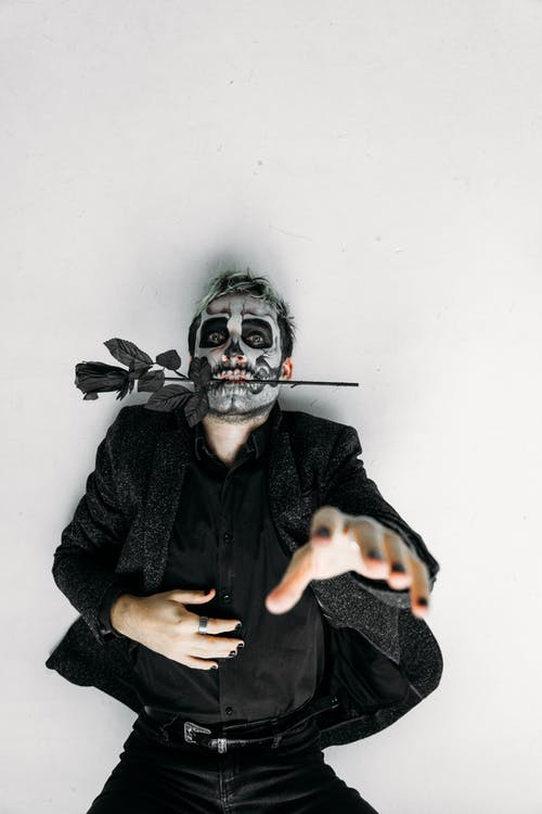 Man Lying On The Floor With A Scary Face Paint