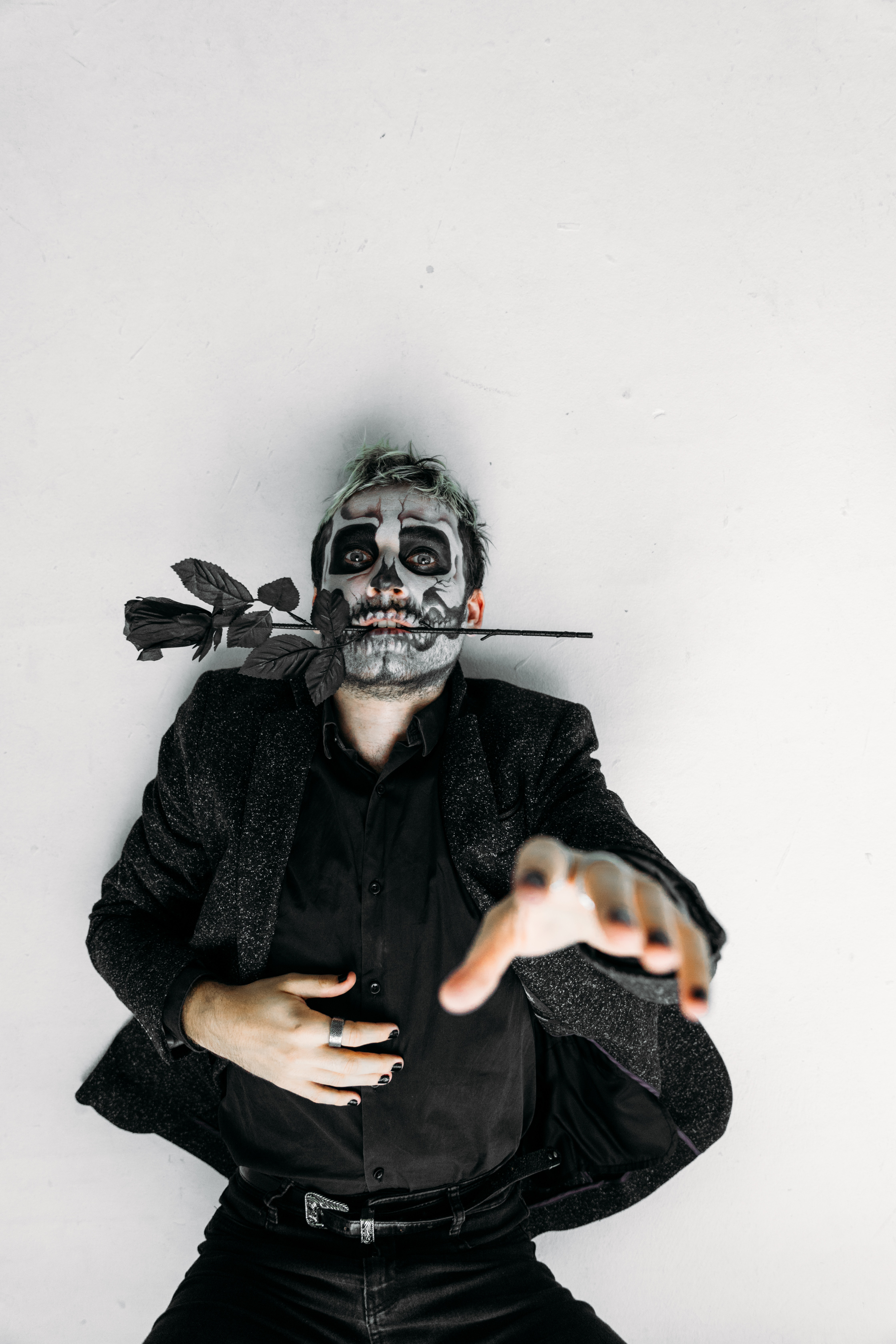 Man Lying On The Floor With A Scary Face Paint Free Stock Photo