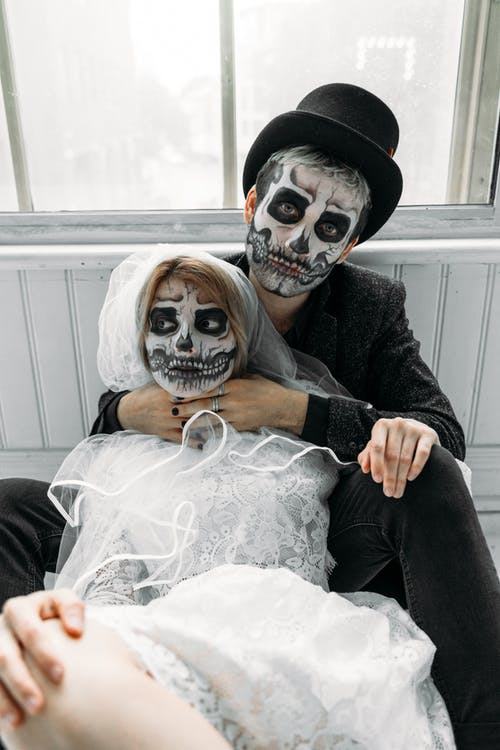 Man And Woman With Scary Face Paints