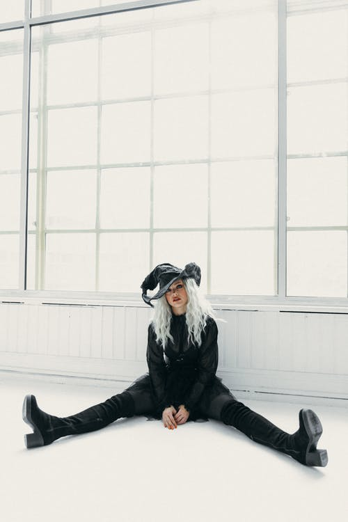 Woman In A Witch Costume Sitting on The Floor