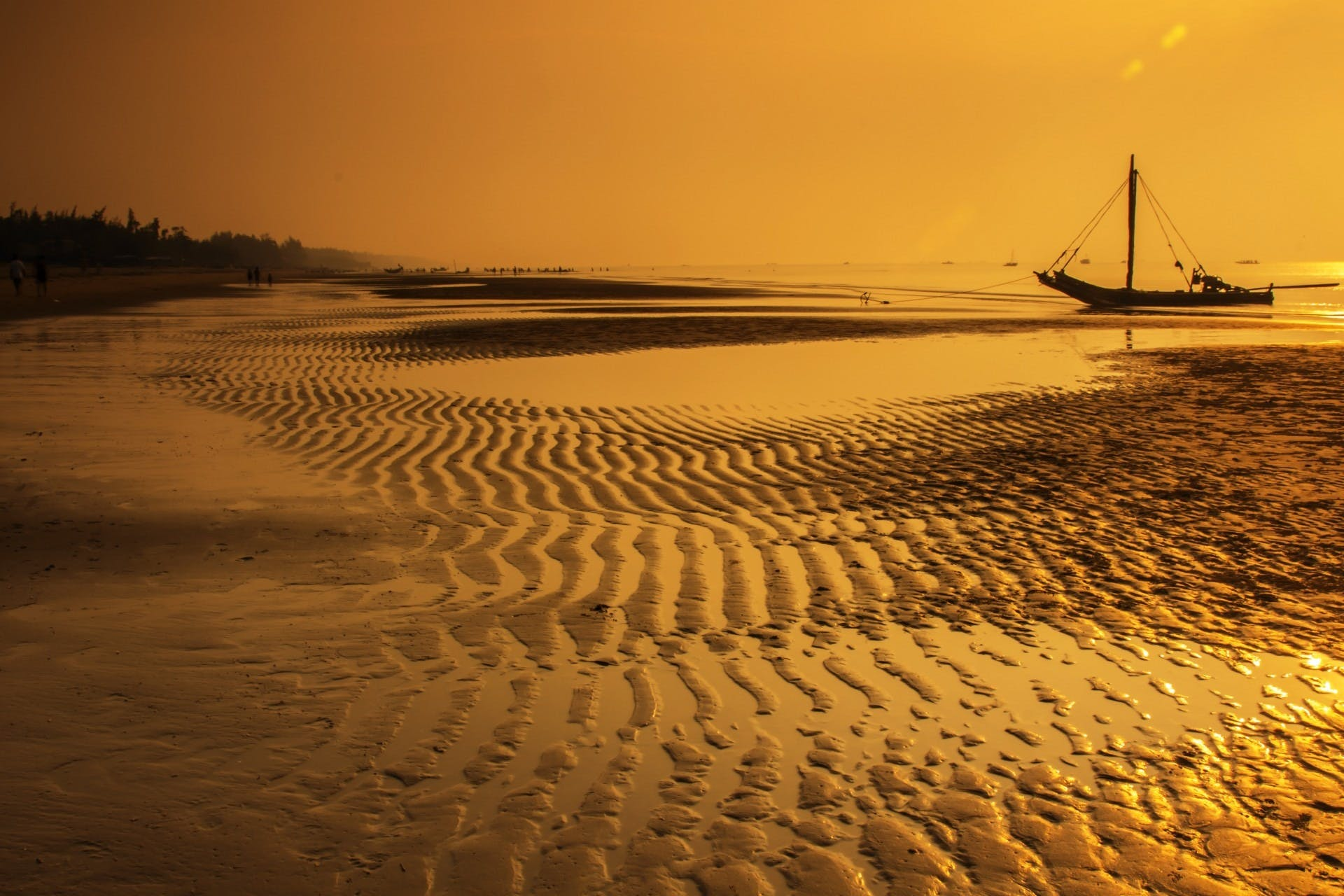 Sea Water With Boat during Sunset