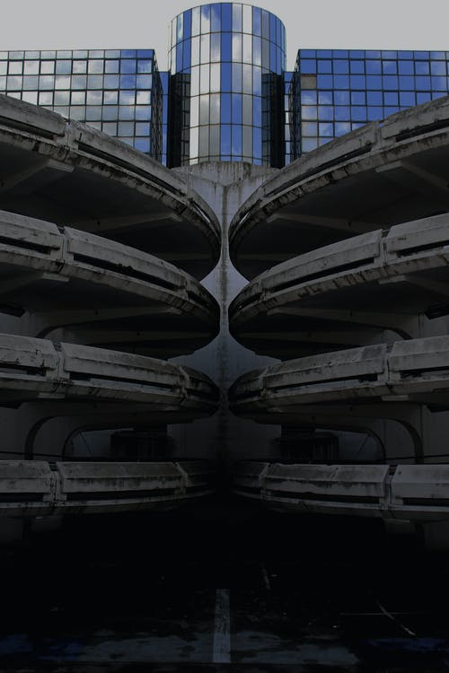 Modern building near multilevel parking