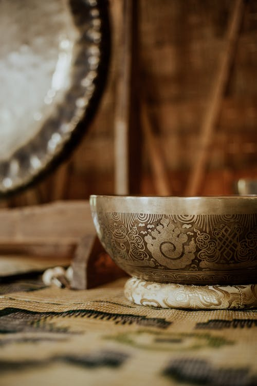 White and Brown Ceramic Bowl on Brown Wooden Table
