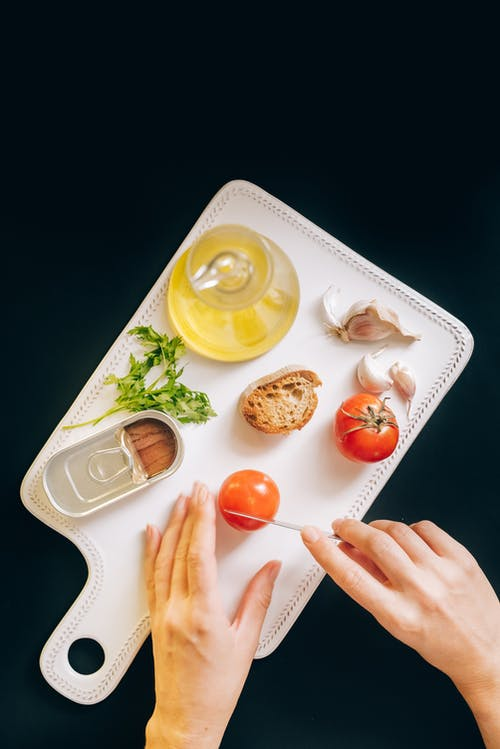 Person Holding White Ceramic Tray With Orange Fruits