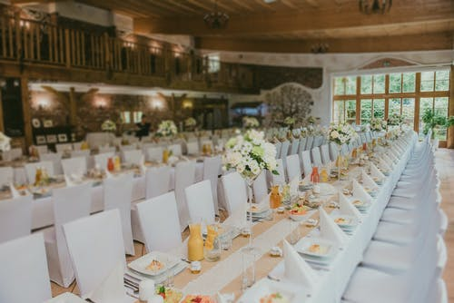 Bright banquet tables with decor on wedding day