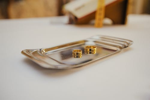Wedding rings on tray on altar table in church