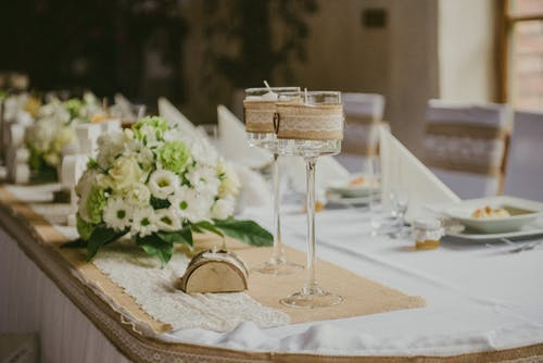 Decorative banquet table with flowers on wedding day