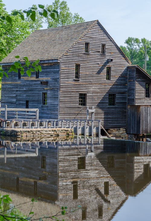 Brown Brick House Beside River
