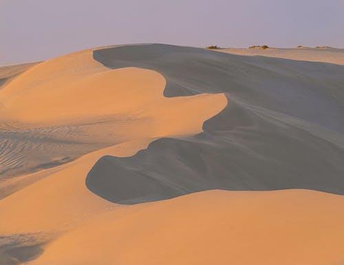 Dry sandy dunes of hor desert in daytime
