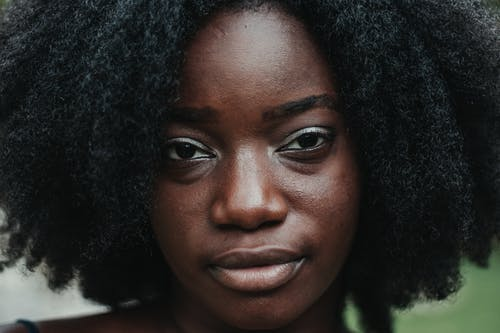Charming adult woman with afro hairstyle