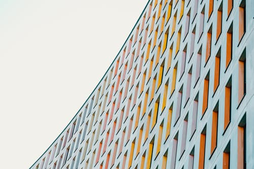 Colorful facade of tall modern construction