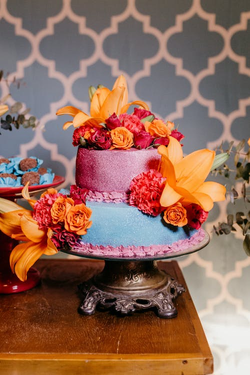 Beautiful cake on wooden banquet table