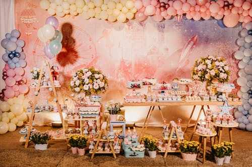 Banquet table with various flowers and balloons